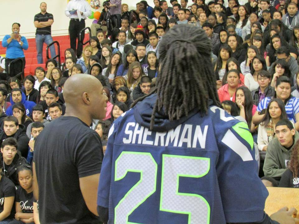 Richard Sherman and Romal Tune speaking to students through SWAG